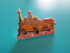 Pin510c Pin´s Pins / Beau Et Rare :  CITROEN AX RALLYE PARIS PEKIN    Marquage Au Dos : - ARTHUS BERTRAND PARIS  - - Arthus Bertrand
