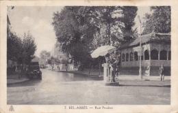 """Bel Abbès - Rue Prudon (carrefour, Gendarme à La Circulation Sous Parasol, Pub """"Buvez Un Crush) Circ, Timbre Décollé - Sidi-bel-Abbes"""