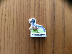 """Fève Disney Pixar """"LE VOYAGE D'ARLO"""" (dinosaure) - Disney"""