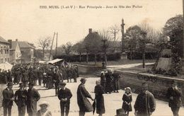 MUEL - Rue Principale - Jour De Fête Des Poilus - Autres Communes