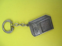 Porte-clé Métallique/Electro Ménager/ Remington / Rasoirs Electriques /Années 1960-1970            POC239 - Porte-clefs