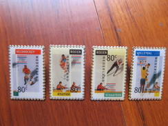 Netherlands Pins With Stamp Shape And Design Of Olympic Games Stamps,four Different - Juegos Olímpicos
