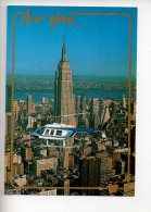 REF 290  : CPM U.S.A. New York Vol En Hélicoptère Empire State Building - New York City