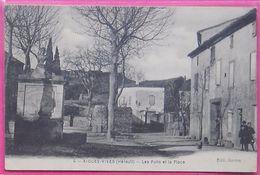 34 Aigues-Vives 1920 Les Puits Et La Place Animée éditeur Azéma N°4 - Other Municipalities