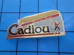 Pin511c Pin´s Pins / Beau Et Rare / ALIMENTATION : CADIOU GATEAU BRETON AUX OEUFS Et Surtout Au Beurre - Alimentation