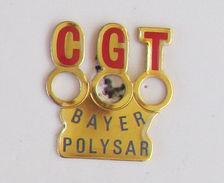 1 Pin's SYNDICAT CGT - BAYER POLYSTAR Signé REDWICK - Associations