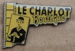 CHARLIE CHAPLIN - LE CHARLOT BOUTIQUE - PELLICULE CINEMA   -                                        (JAUNE) - Celebrities