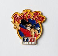Pin's TF1 Video Rock O Rico - 37R - Pin's
