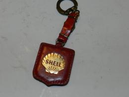 PORTE CLEF  SHELL DORE SUR FOND CUIR ROUGE - Porte-clefs