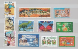 FRANCE 2000 LOT 11 TIMBRES DIFFERENTS DONT CARCASSONNE JO SYDNEY TINTIN PHARE  ETC... - France