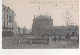 CPA..LUSSAT.PLACE DE LA FONTAINE.JOLIE CARTE ANIMEE. - France