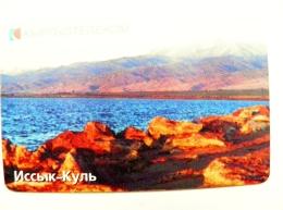 Chip Phone Card From Kyrgyzstan Landscape Issyk Khul Lake Mountains Berg Europa Plus - Kirgisistan