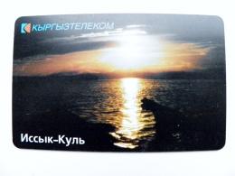 Chip Phone Card From Kyrgyzstan Landscape Issyk Khul Lake Sunset Aqualand - Kirgizië