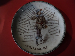 VIEILLE ASSIETTE PARLANTE MR DE LA PALISSE. TERRE DE FER / HB ET CIE COULEURS. N°1. - Borden