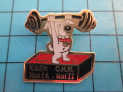 Pin0113b  Pin's Pins / Beau Et Rare : SPORT / HALTEROPHILIE CHIEN CAEN HALTERE - Weightlifting