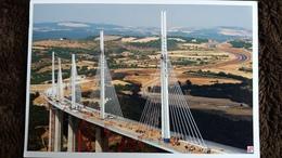 CPM PONT VIADUC DE MILLAU EN CONSTRUCTION PHOTO DANIEL JAMME COLLEE POUR CP - Puentes