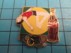 Pin2417 Pin's Pins / COCA-COLA SAUT EN HAUTEUR JEUX OLYMPIQUES Superbe Et Grand Pin's Par ARTISS REGINA - Coca-Cola