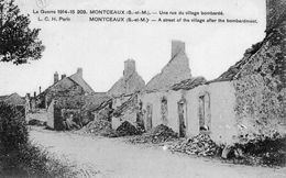 CPA -MONTCEAUX - UNE RUE DUVILLAGE BOMBARDEE - Autres Communes