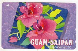GUAM  SAIPAN TELECARTE JAPON FLEUR - Guam
