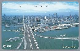 JP.- Japan, Telefoonkaart. Telecarte Japon. NTT. TELEFHONE CARD 105. TOKYO BAY. BRUG BOOT. HAVEN. - Landschappen
