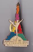 PIN'S THEME SPORT GYMNASTIQUE CHAMPIONNAT DU MONDE PARIS 1992 TOUR EIFFEL - Gymnastics