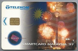 MY.- Telefoonkaart. TELEKOM MALAYSIA. 1997. Kuala Lumpur Tower. Vuurwerk. - Bloemen