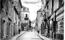 (03) - NERIS LES BAINS - LA LIBRAIRIE ET BIJOUTERIE RUE DU COMMERCE Bb-44 - Neris Les Bains