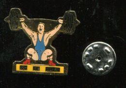 Pin's - LE RHEU Halterophilie - 35 Ille Et Vilaine - Weightlifting
