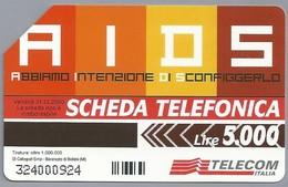 IT.- SCHEDA TELEFONICA. TELECOM ITALIA LIRE 5.000. AIDS. ABBIAMO INTENZIONE DI SCONFIGGERLO. 2 Scans - Italië
