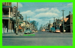 STURGEON FALLS, ONTARIO - KING STREET, THE MAIN ANIMATED BUSINESS SECTION -  Wm R. FORDER - - Ontario