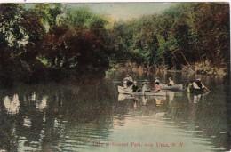 New York Utica Canoeing On Lake At Summit Park