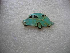 Pin's Automobile Coccinelle Bleue De La Marque Volkswagen - Volkswagen
