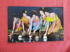 "Thailand--Ladies Enjoying The ""Loy Krathong"" Festival Lighting Flowers---  Ref 2769 - Thailand"