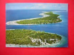 CPM RANGIROA PASSE ET VILLAGE DE TIPUTA   NON VOYAGEE CARTE EN TRES BON ETAT - Polynésie Française