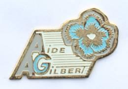 Pin's AAG - Aide A Gilbert - Fleur De Pensée - G1100 - Associations
