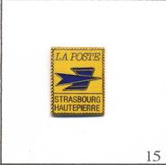 Pin's PTT / Télécom -  La Poste / Strasbourg Hautepierre (67) En Forme De Timbre. Estampillé Toled. EGF. T565-15 - Mail Services