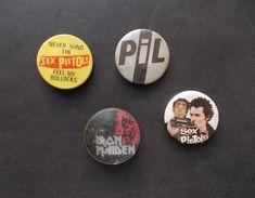 """- Lot De 4 Anciens Badges """"IRON MAIDEN - PIL - SEX PISTOLS"""" - - Music"""