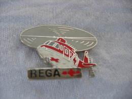 Pin's Helicoptere AGUSTA A-109 K2 De La REGA. (Garde Aérienne Suisse, Disponible En Tout Temps Pour Urgences Médicales). - Airplanes