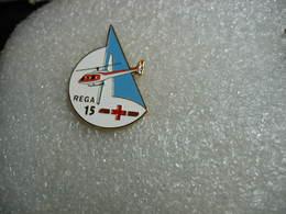 Pin's Helicoptere HB-XVB De La REGA. (Garde Aérienne Suisse, Disponible En Tout Temps Pour Urgences Médicales). - Airplanes