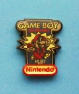 1 PIN'S  //   ** GAME BOY ** ACCESSOIRES ** NUBY ** NINTENDO ** - Games