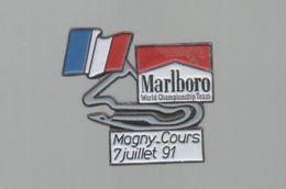 PINS PIN'S AUTO AUTOMOBILE COURSES RALLYE F1 MAGNY COURS FRANCE  7 07 1991 CIGARETTES MARLBORO DRAPEAU - Car Racing - F1