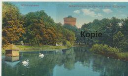 AK Wilhelmshaven, Schwanenteich / Wasserturm (Stempel: Marine Schlächterei) - Wilhelmshaven