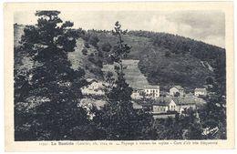 Cpa La Bastide - Paysage à Travers Les Sapins ... - France