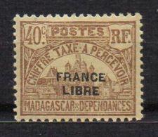 MADAGASCAR ( TAXE ) : Y&T  N°  23  TIMBRE  NEUF  AVEC  TRACE  DE  CHARNIERE  , A  VOIR . - Madagascar (1889-1960)