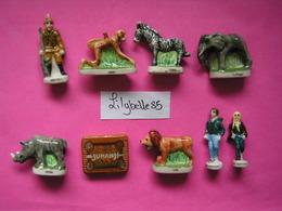 Série Complète De 9 Fèves Anciennes En Porcelaine - JUMANJI - PAQUES 1996 ( Feve) - Charms