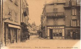SAINT-GENIEZ (-d'OLT, Aveyron) - RUE Du COMMERCE - Commerces - Animée - Non Voyagée - Jaunie (voir Scans) -> Prix Adapté - Frankreich