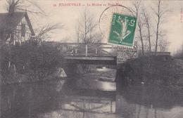 50. JULLOUVILLE. CPA  . LA RIVIÈRE AU PONT BLEU . ANNÉE 1914. - Carteret