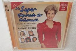 """2 CDs """"Die Super-Hitparade Der Volksmusik"""" Vorgestellt Von Carolin Reiber - Música & Instrumentos"""