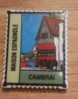 59 - CAMBRAI - FEVE PERSONNALISEE MAISON  ESPAGNOLE - FORME DE TIMBRE - BRILLANTE - Regions