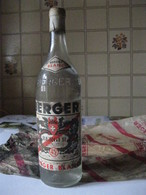 Ancienne Bouteille De Berger Blanc 45°, Avec Son Papier D'emballage. - Other Collections